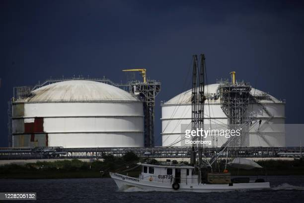 Shrimp boat moves past storage tanks at the Sabine Pass LNG Export Terminal ahead of Hurricane Laura in Sabine Pass, Texas, U.S., on Tuesday, Aug....