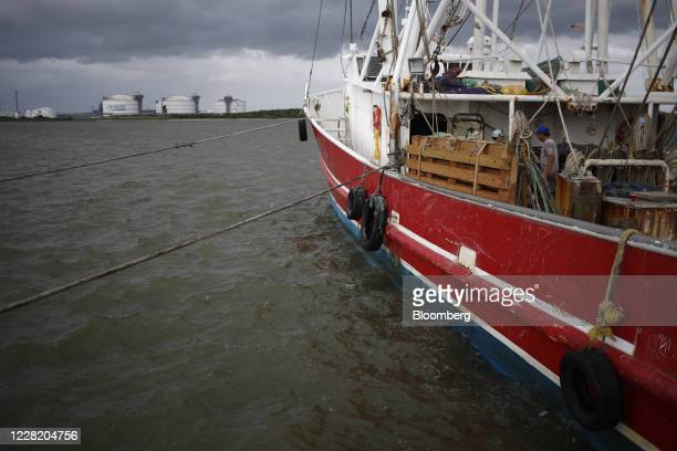 Shrimp boat sits anchored near the Gulf of Mexico ahead of Hurricane Laura in Sabine Pass, Texas, U.S., on Tuesday, Aug. 25, 2020. Hurricane Laura is...