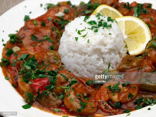 shrimp dish with white rice on a white plate - creole culture stock pictures, royalty-free photos & images