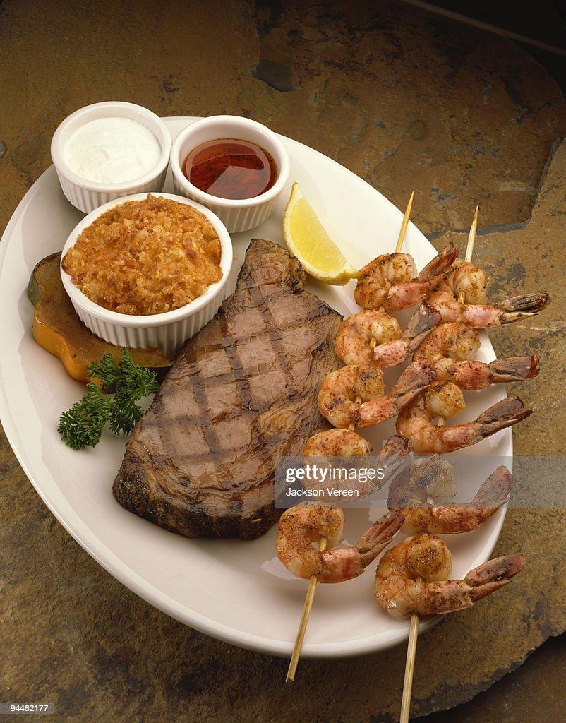 Shrimp kebabs and steak : Stock Photo