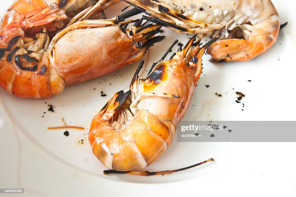 shrimp on the grill ready to eat : Stock Photo