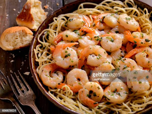 shrimp scampi with pasta - bechamel sauce stock photos and pictures
