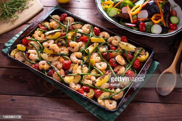 shrimp sheet pan - baking sheet stock pictures, royalty-free photos & images