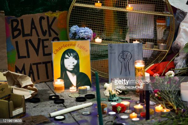 Shrine and a photo of Charleena Lyles are pictured in an area being called the Capitol Hill Autonomous Zone located on streets reopened to...