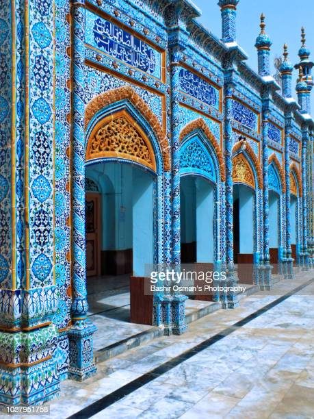 shrine of saint jhurial shah and the mosque alongside - pakistani culture stock photos and pictures