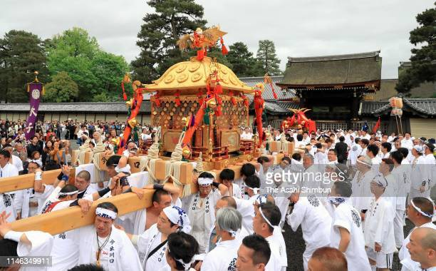 Shrine parishioners carrying a 'Mikoshi' portable shrine to celebrate the new era 'Reiwa' at Kyoto Gyoen Park on May 1 2019 in Kyoto Japan New...