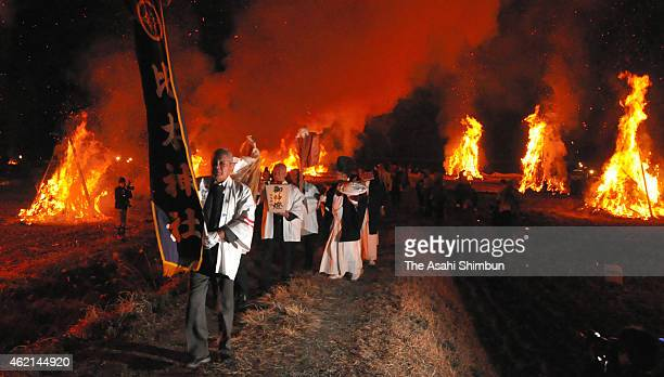 Shrine parishioners march on among bon fires during the Shiwasu Festival on January 23 2015 in Misato Miyazaki Japan The festival is said to be a...