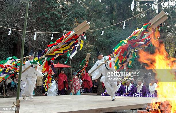 Shrine priests throws fourmeterlong 'Gohei' during the ChinEki Festival on February 13 2005 in Usa Oita Japan