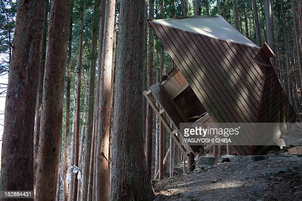 A shrine rests in a wood after the recent Tsunami in Kesennuma city Miyagi prefecture on April 14 2011 Japan's seismologists were so entrenched in...