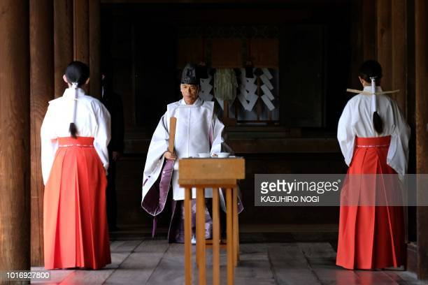 Shrine staff are seen in a corridor of the Yasukuni shrine on the 73rd anniversary of Japan's surrender in World War II in Tokyo on August 15 2018...