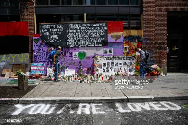 TOPSHOT A shrine to George Floyd and others is pictured in the newly created Capitol Hill Autonomous Zone in Seattle Washington on June 11 2020 The...