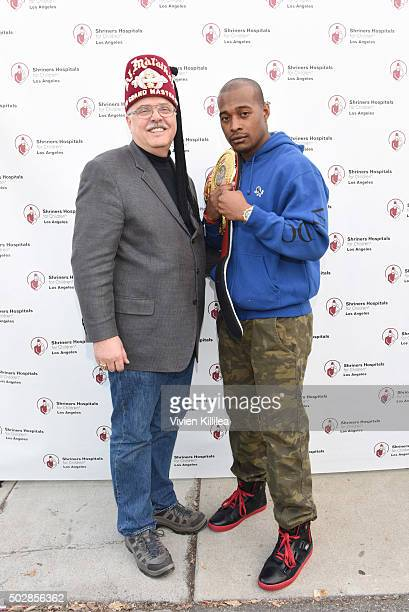 Shriners Hospitals for Children - Los Angeles board chairman David R. Doan and boxer Brian Reynolds attend Celebrities Decorate The Shriners Rose...