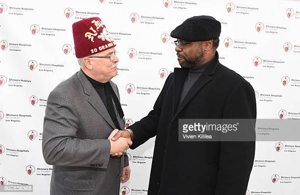 Shriners Hospitals for Children Los Angeles board chairman David R Doan and TV personality Petri HawkinsByrd attend Celebrities Decorate The Shriners...