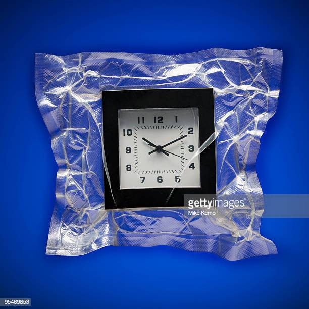 Shrink wrapped clock
