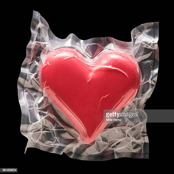 shrink wrapped heart - heart internal organ stock pictures, royalty-free photos & images