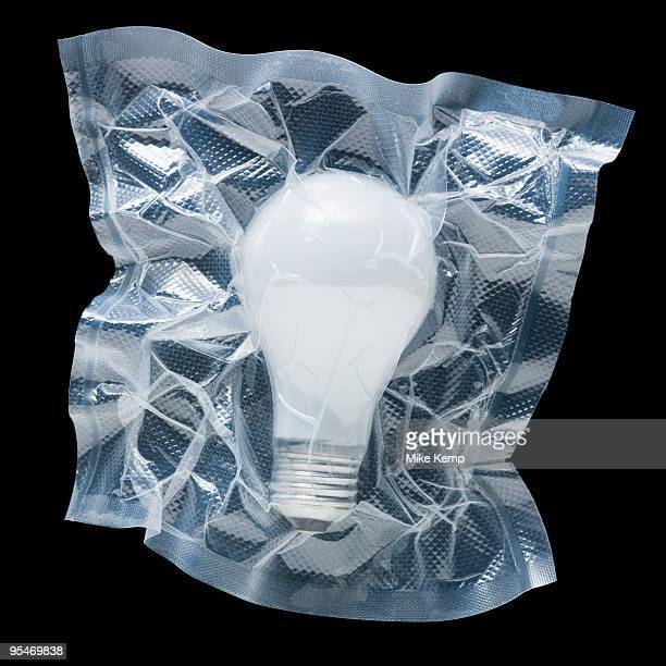 shrink wrapped light bulb - airtight stock photos and pictures
