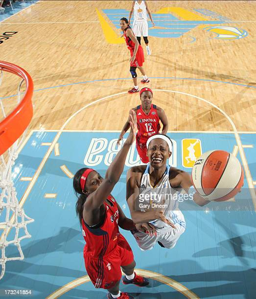 Shrnee' Zoll Norman of the Chicago Sky goes to the basket past Crystal Langhorne and Ivory Latta of the Washington Mystics during the game on July 10...