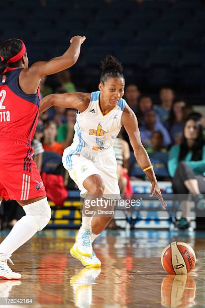 Shrnee' ZollNorman of the Chicago Sky drives past Ivory Latta of the Washington Mystics during the game on July 10 2013 at the Allstate Arena in...