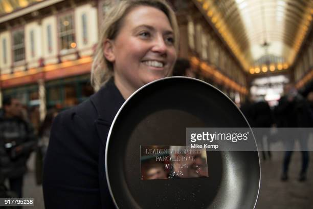 Shrove Tuesday festivities as The City Flippers celebrate winning the Leadenhall Market Pancake Day Race on 13th February 2018 in London United...