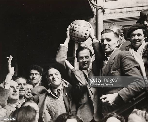 'Shrovetide Football at Ashbourne' 1952 A photograph of the Duke of Devonshire holding aloft the handpainted football which he 'turned up' to start...