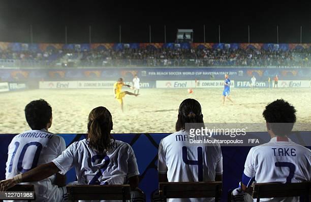 Shsei Yamauchi, Takashi Arakaki, Shinji Makino and Takeshi Kawaharazuka watch the action from the bench during the preview match between Italy and...