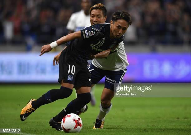 Shu Kurata of Gamba Osaka and Ryosuke Yamanaka of Yokohama F.Marinos compete for the ball during the J.League J1 match between Gamba Osaka and...
