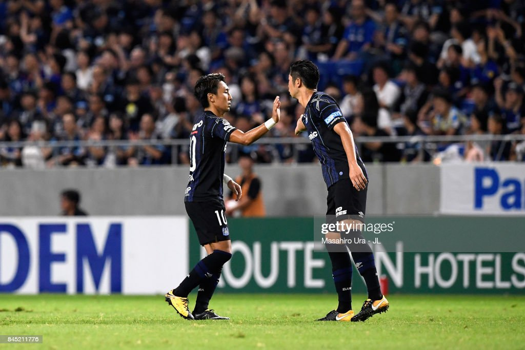Shu Kurata (L) of Gamba Osaka celebrates scoring his side's first goal with his team mate Genta Miura (R) during the J.League J1 match between Gamba Osaka and Vissel Kobe at Suita City Football Stadium on September 9, 2017 in Suita, Osaka, Japan.