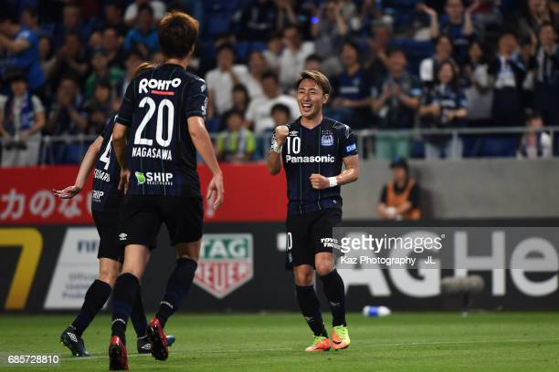 Shu Kurata of Gamba Osaka celebrates scoring his side's second goal with his team mates during the JLeague J1 match between Gamba Osaka and Sagan...