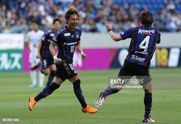 Shu Kurata of Gamba Osaka celebrates scoring the opening goal with his team mate Hiroki Fujiharu during the JLeague J1 match between Gamba Osaka and...
