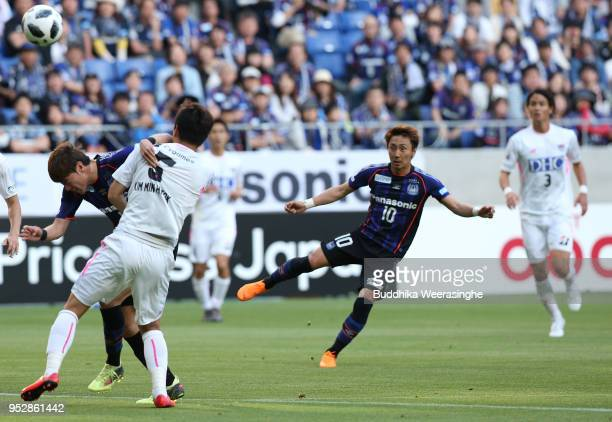 Shu Kurata of Gamba Osaka scores the opening goal during the JLeague J1 match between Gamba Osaka and Sagan Tosu at Suita City Football Stadium on...
