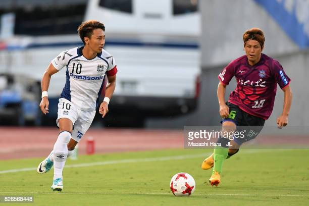 Shu Kurata of Gamba Osaka takes on Masaru Matsuhashi of Ventforet Kofu during the JLeague J1 match between Ventforet Kofu and Gamba Osaka at...