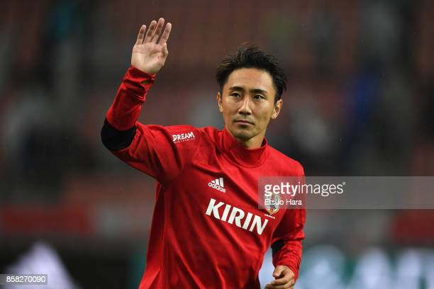 Shu Kurata of Japan applauds supporters after his side's 21 victory in the international friendly match between Japan and New Zealand at Toyota...