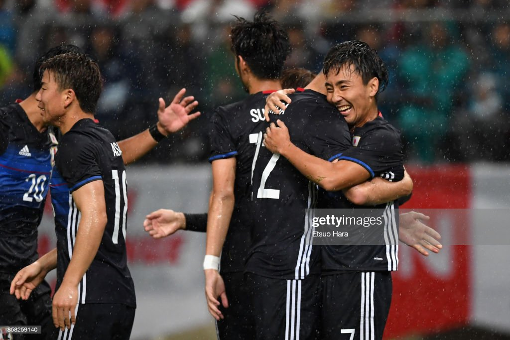 Shu Kurata (1st R) of Japan celebrates scoring his side's second goal with his team mates during the international friendly match between Japan and New Zealand at Toyota Stadium on October 6, 2017 in Toyota, Aichi, Japan.