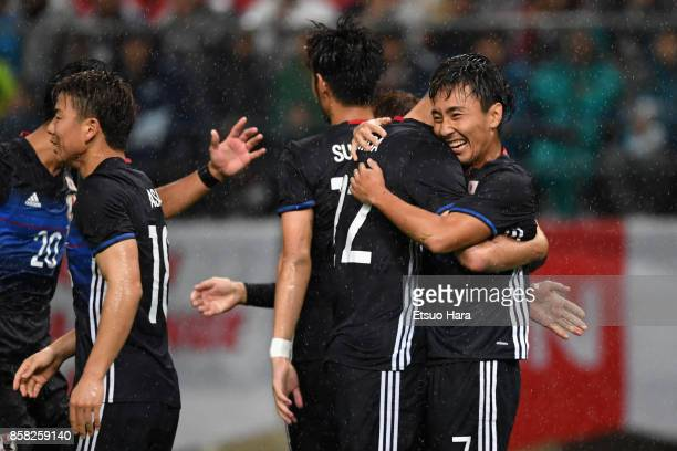 Shu Kurata of Japan celebrates scoring his side's second goal with his team mates during the international friendly match between Japan and New...