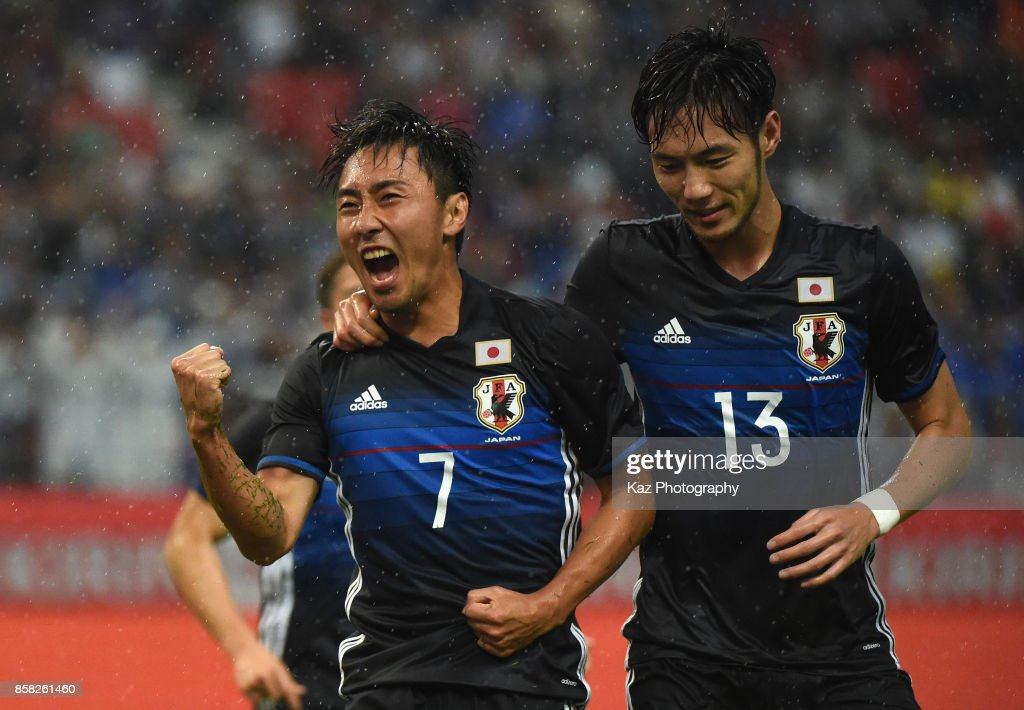 Shu Kurata (L) of Japan celebrates scoring his side's second goal with his team mate Kenyu Sugimoto (R) during the international friendly match between Japan and New Zealand at Toyota Stadium on October 6, 2017 in Toyota, Aichi, Japan.