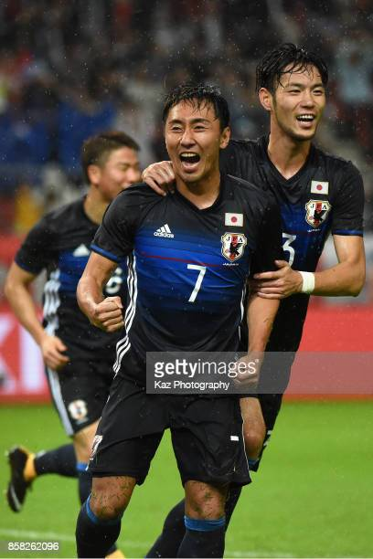 Shu Kurata of Japan celebrates scoring his side's second goal with his team mate Kenyu Sugimoto during the international friendly match between Japan...