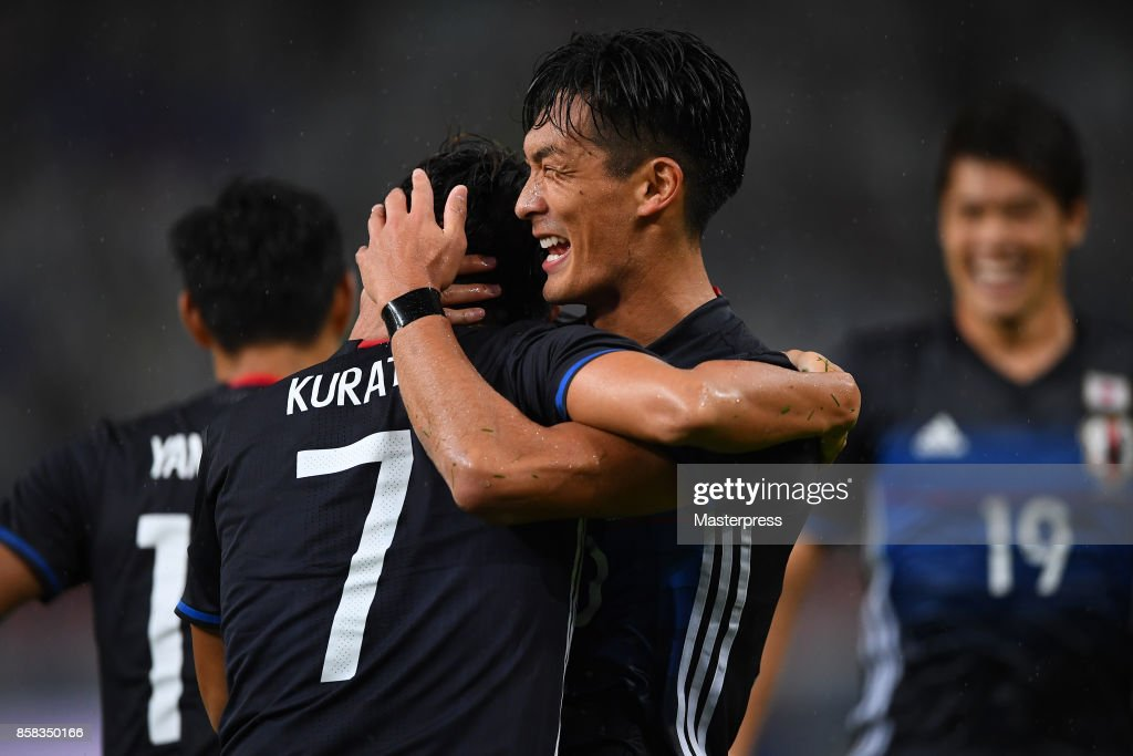 Shu Kurata(L) of Japan celebrates scoring his side's second goal with his team mate Tomoaki Makino(R) during the international friendly match between Japan and New Zealand at Toyota Stadium on October 6, 2017 in Toyota, Aichi, Japan.