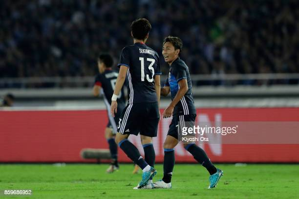 Shu Kurata of Japan celebrates scoring the opening goal with his team mate Kenyu Sugimoto during the international friendly match between Japan and...