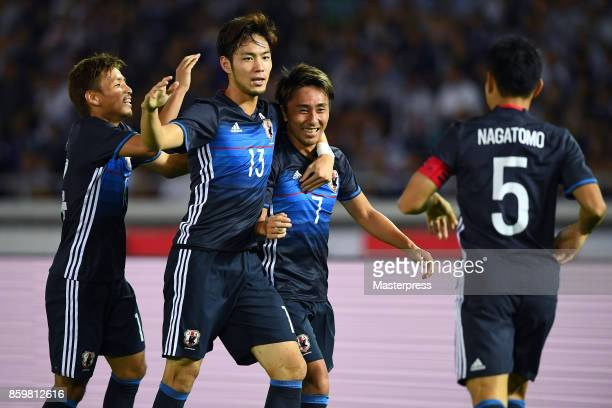 Shu Kurata of Japan celebrates scoring the opening goal with his team mates during the international friendly match between Japan and Haiti at Nissan...