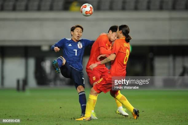 Shu Kurata of Japan competes for the ball against Chinese defense during the EAFF E1 Men's Football Championship between Japan and China at Ajinomoto...