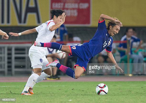 Shu Kurata of Japan vies for the ball in group match between Japan and South Korea during EAFF East Asian Cup 2015 at Wuhan Sports Center Stadium on...