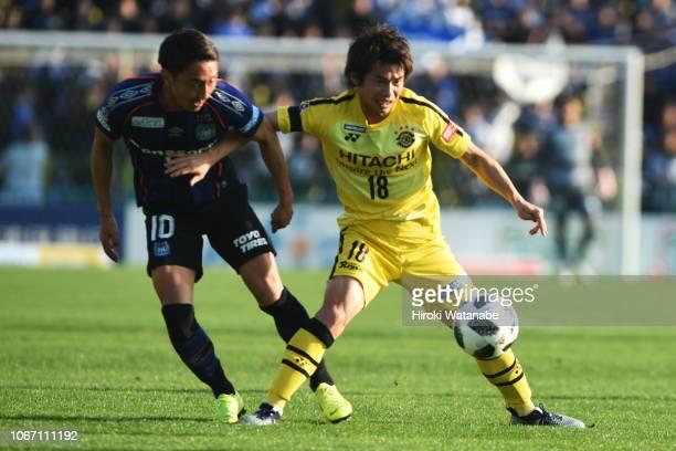 Shu Kurata#10 of Gamba Osaka and Yusuke Segawa#18 of Kashiwa Reysol compete for the ball during the JLeague J1 match between Kashiwa Reysol and Gamba...