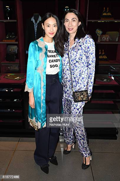 Shu Pei and Anh Duong attend the Dolce Gabbana pyjama party at 5th Avenue Boutique on March 15 2016 in New York City
