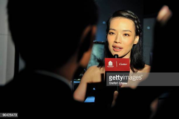Shu Qi Taiwanese actress speaks to reporters at the opening of the 'Cartier Treasures' exhibition at the Forbidden City September 4 2009 in Beijing...