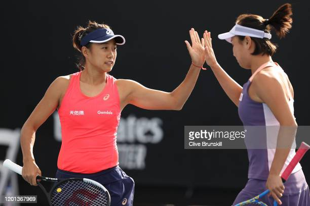 Shuai Peng and Shuai Zhang of China high five during their Women's Doubles first round match against Veronika Kudermetova of Russia and Alison Riske...