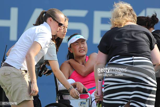 Shuai Peng China retires from the game through injury during her match with Caroline Wozniacki Denmar in the Women's Singles Semifinal during the US...