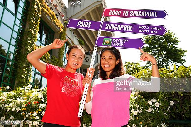 Shuai Peng of China and SuWei Hsieh of Chinese Taipei pose with the 'Road to Singapore' sign after their victory in the women's doubles final match...