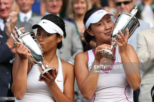 Shuai Peng of China and SuWei Hsieh of Taipei kiss the Ladies' Doubles trophies after their Ladies' Doubles final match against Ashleigh Barty of...