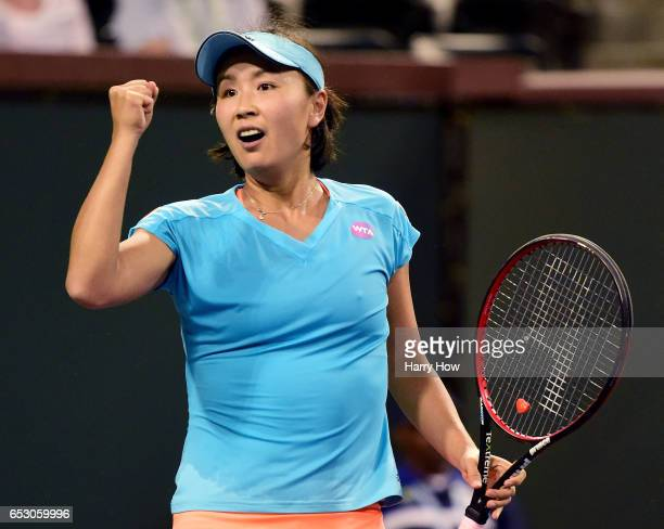 Shuai Peng of China celebrates match point for her win over Agnieska Radwanska of Poland during the BNP Paribas Open at Indian Wells Tennis Garden on...