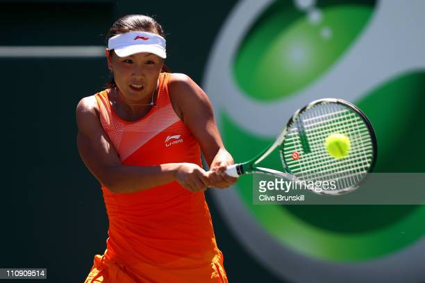 Shuai Peng of China hits a backhand return against Svetlana Kuznetsova of Russia during the Sony Ericsson Open at Crandon Park Tennis Center on March...